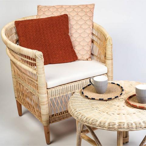 Ilios fauteuil en rotin tressé couleur beige.